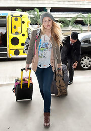Whitney Port got ready to depart LA in a pair of fitted skinny jeans and layered tops.