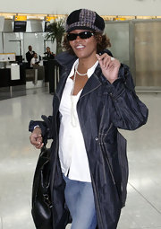 Whitney Houston wore all black sunglasses while traveling in London.