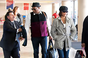Singer Whitney Houston wore a grey newsboy cap while traveling through LAX airport.
