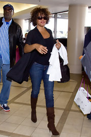 Whitney Houston was seen at LAX wearing a fall-inspired outfit including a pair of mid-calf boots.