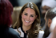Kate was a fresh-faced beauty at the Summerfield Community Centre with brown locks and lined eyes.