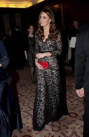 Kate Middleton gave her gorgeous Alice Temperley gown a pop of color with a bright hard case clutch.