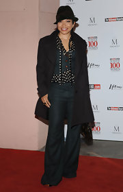 Tisha channeled Diane Keaton in a shrunken  vest and matching wide-legged trousers. The actress topped off the androgynous look with a black fedora and matching trench.