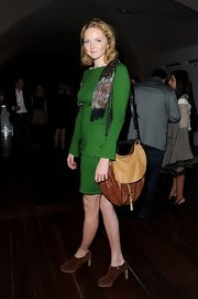 Lily Cole teamed a two-tone leather hobo bag with her sweater dress when she attended the World Chess Grand Prix.