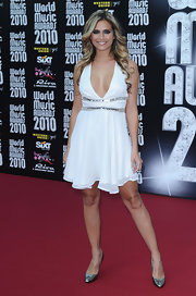 Clara Morgane was a winter white sensation in this white halter dress.
