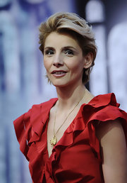 Clotilde Courau slicked her cropped mane back while attending the World Music Awards.