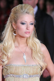 Paris Hilton wore a silver wing necklace for her dramatic look at the World Music Awards.