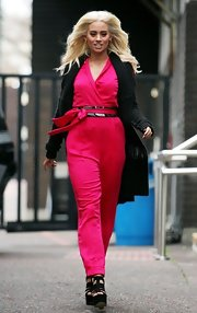Kimberly Wyatt brightened up winter in a hot pink jumpsuit.