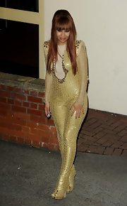 Rebecca Ferguson looked like she just stepped out of a sci-fi movie in this shimmery yellow jumpsuit as she left the 'X Factor' studios.