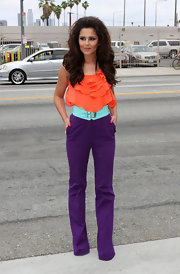 Cheryl was a vibrant pop of colors on her way to the 'X-factor' in an orange ruffled top.