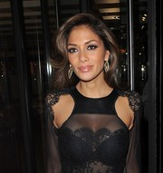 Nicole Scherzinger stepped out for dinner in London looking glamorous with this high-volume wavy 'do.