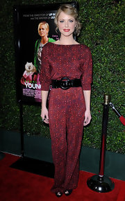 Collette Wolve cinched her waist with a black patent oversized belt at the 'Young Adult' premiere.