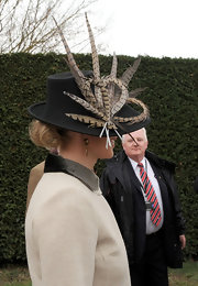 Zara Phillips' feather hat added a touch of flamboyance to her subdued look at Gold Cup Day.