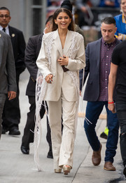Zendaya Coleman headed to 'Kimmel' wearing a cream-colored Ports 1961 pantsuit with a crochet overlay.