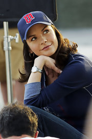 Catherine Zeta Jones wears a baseball cap on the set of her new film 'The Rebound'.