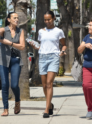 Zoe Saldana teamed her shirt with a pair of denim shorts.