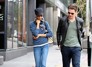 Zoe Saldana kept a low profile in LA wearing a heather blue crewneck sweater and a plaid scarf.