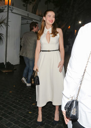 Zoey Deutch paired her frock with a black chain-strap bag, also by Dior.