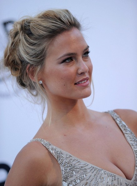 Bar Refaeli styled her hair in a loose textured updo that was then pinned into place. Her elegant hairstyle was a perfect addition to her glamorous look.  Lovely lady, lovely hairstyle!