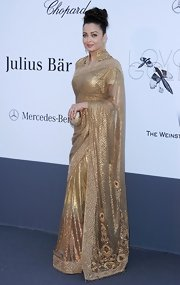 Aishwarya Rai opted for a more traditional look at the amFAR Cinema Against AIDS Gala where she wore this golden sari.