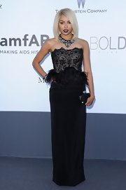 Kat Graham mixed elegance and edginess when she wore this  black gown with a lace bodice and feather peplum.