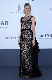 Angela Lindvall looked regal in this floral lace column dress that featured black lace detailing on the back.