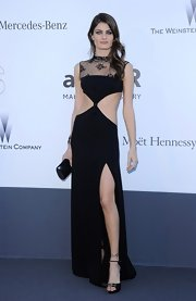 Isabeli Fontana showed off her toned tummy with this black column dress that featured a lace neckline and stomach cutouts.