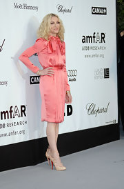 Madonna attended the Amfar Awards in a coral colored long sleeve dress. She topped off her classy look with a coveted pair of lace up pumps.