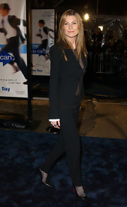 Ellen wore pointed leather pumps with her sleek tailored suit.