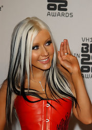 Christina Aguilera no longer wears any jewelry in her lip piercing.