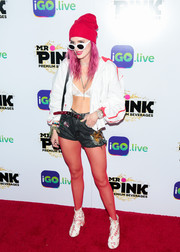 Bella Thorne hit the iGo.live launch event wearing a white and red track jacket over a lace bra.