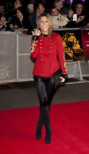 Nicole Appleton was looking like one fashionable ringleader in this crimson and gold military-inspired jacket.