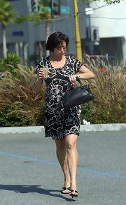 Catherine Bell looked cool and casual in a black-and-white floral maternity dress.