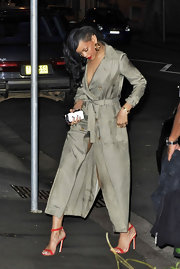 Rihanna went out to dinner wearing an ultra-long trench and sexy strappy red sandals.