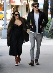 Vanessa Hudgens looked boho-chic in these tan ankle booties and an oversized furry sweater.