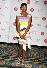 Estelle wore a printed silk dress with gray woven leather Safron sandals.