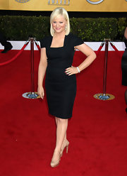 Amy Poehler streamlined her look with nude platform slingbacks.