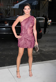 Hilary Rhoda wore a cutstom dress from Calvin Klein Collection and carried a jeweled python clutch.