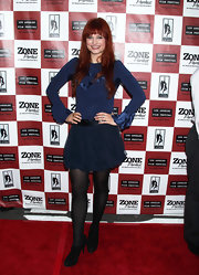 Alison's fiery red hair complemented her navy ensemble.