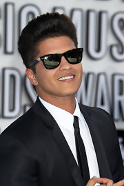 Bruno added a dash of style to his suit with wayfarer shades.