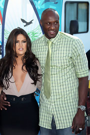 Lamar paired his plaid shirt with a matching lime green tie.