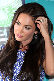 Megan Fox showed off her silver dangle earrings while hitting the Teen Choice Awards.
