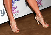 Megan Gale sported a pair of nude-colored strappy sandals to Vogue's Fashion Night Out event.