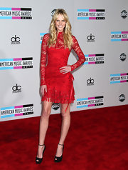 Anne V paired her red lacy dress with black peep-toe pumps complete with ankle strap detailing.