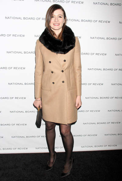 Emily outsmarted the rest in a warm camel coat with a fur collar.