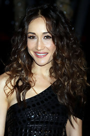 Maggie Q gave her bouncy curls a sleek center part at the 2011 People's Choice Awards.
