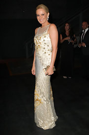 Charlotte Dawson accented her glam gown with a petite gold hard case clutch.