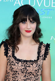 Zooey Deschanel drew attention to her full lips with a swipe of matte crimson lipstick.