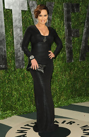 Tia Carrere wore this long-sleeve black gown to the Vanity Fair Oscar party.