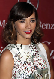 Rashida completed her ravishing red lips with side swept curls.